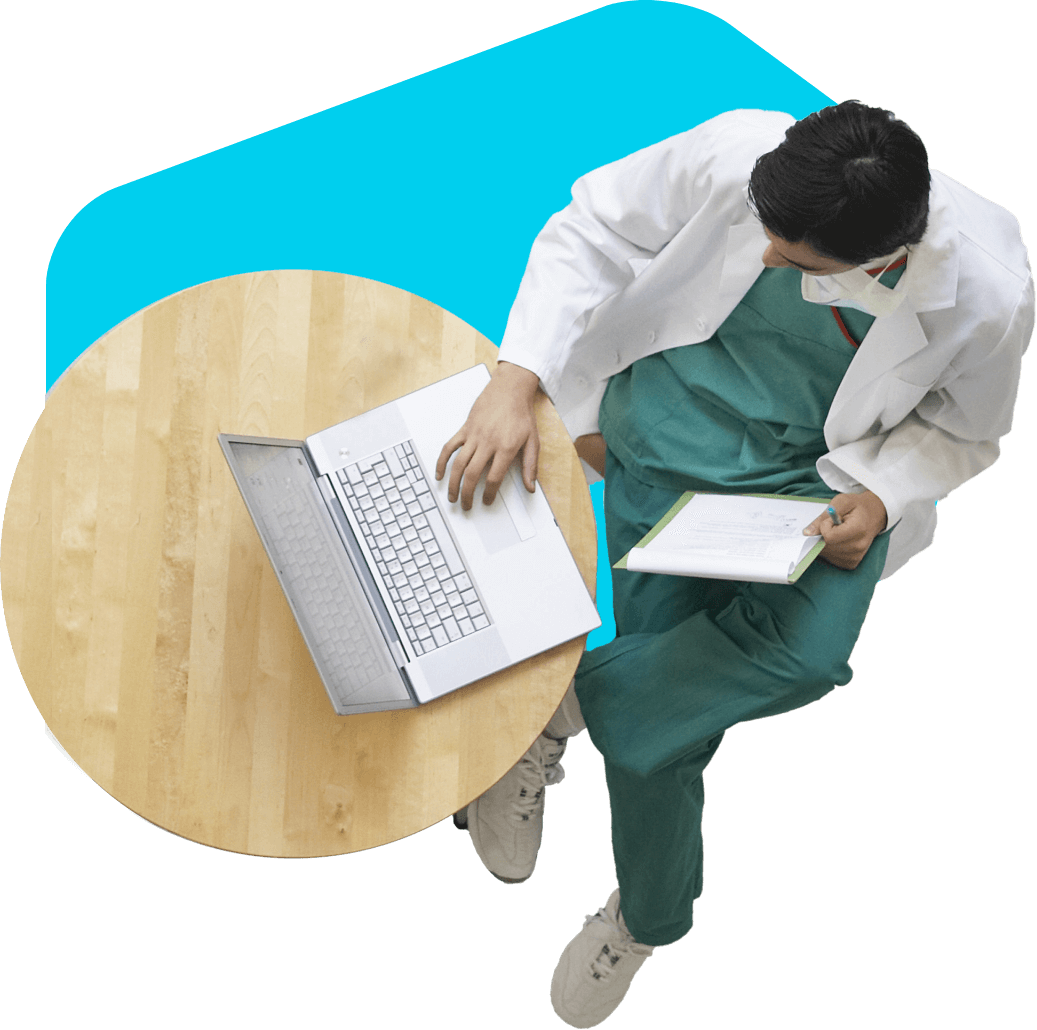 Doctor at table using laptop