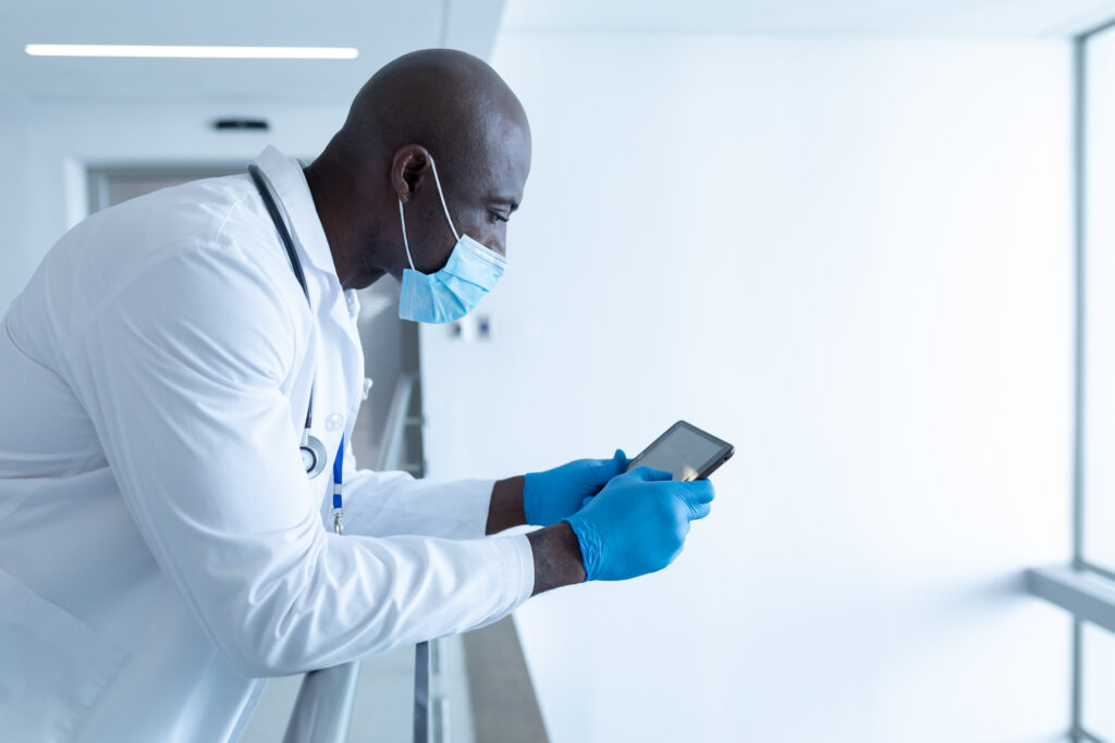 Healthcare worker on frontline with tablet